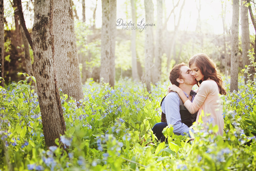 spring engagement session in the woods with bluebells